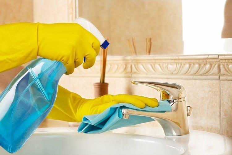 Spraying Bathroom Faucet with Vinegar