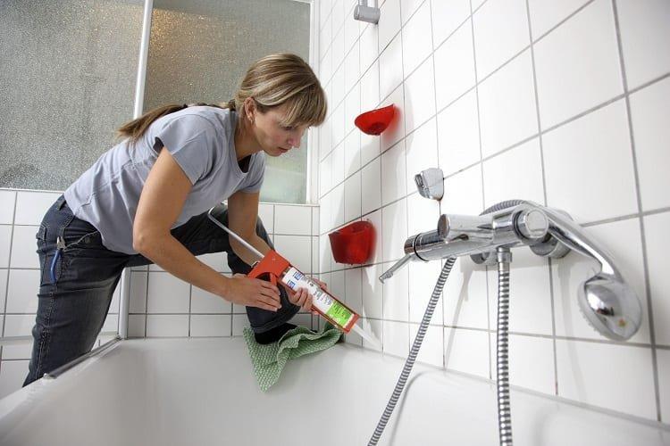 Woman Siliconizing Bathtub
