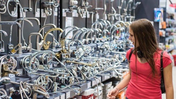 Woman Choosing Faucet