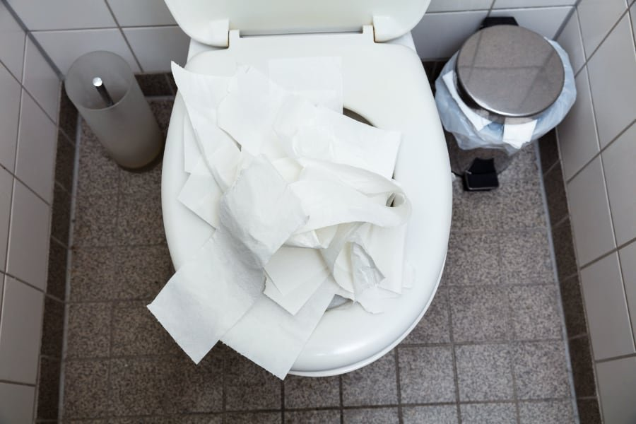 clogged toilet with paper
