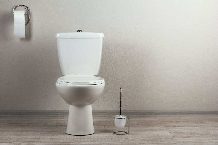 white toilet in bathroom